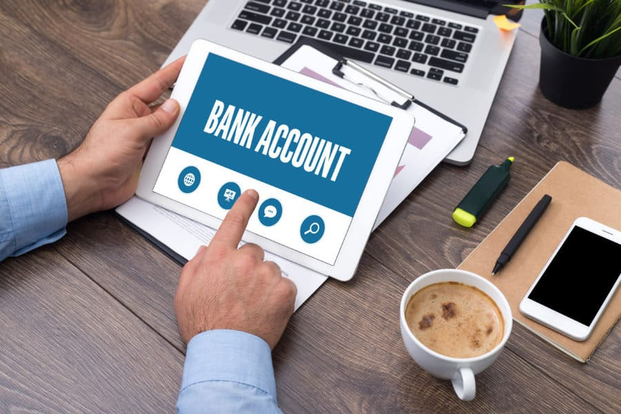 Person holding bank account documents
